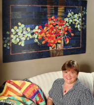 Image - Ellen Lindner in front of bright quilt